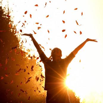Happy_Woman_Autumn_Leaves.jpg